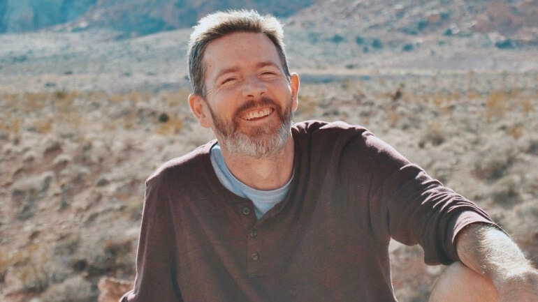 Man evaluating term life insurance policies