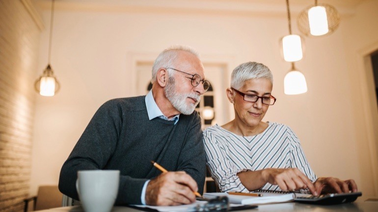 Couple reviewing how to sell their term life insurance policy