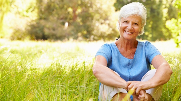 Senior woman sitting outside thinking about things to know about selling life insurance.