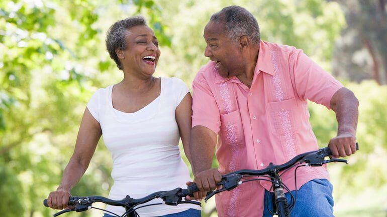 A couple on bikes pleased to hear that cashing out a whole life insurance policy is untaxed.