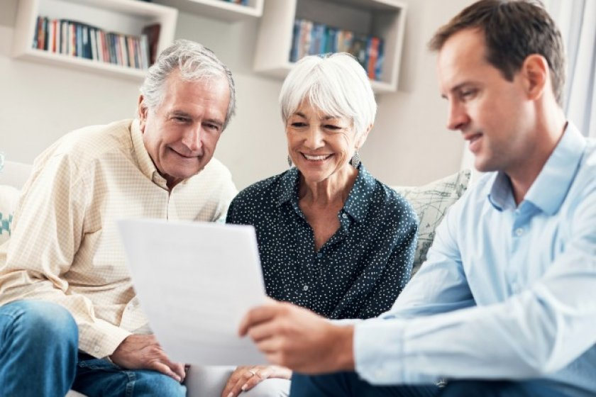 Senior couple getting some financial help from an advisor.