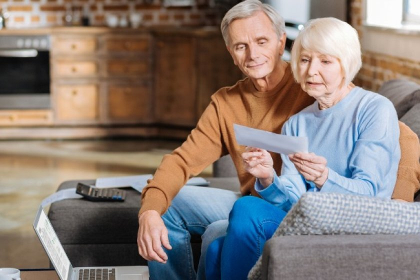 Elder couple checking out their social security statement.