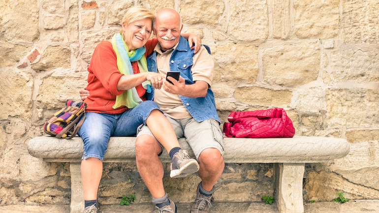 A senior couple on vacation after finding out how long a life insurance buyout takes.