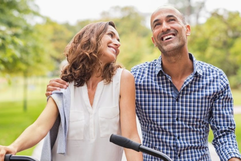 Couple bike riding wondering is disability insurance worth it.