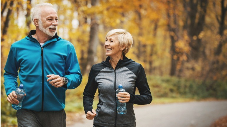 Couple jogging thinking long term care insurance is worth it.