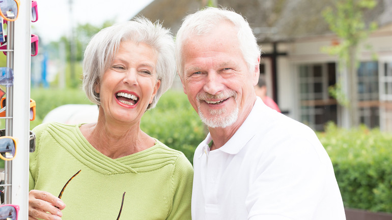 Happy couple discussing a life insurance buyout.