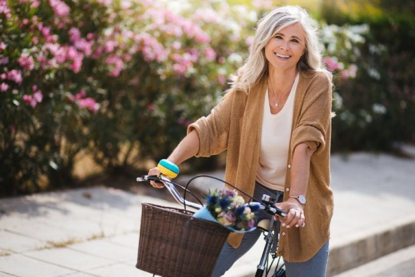 elderly woman riding bike thinking of life insurance grace period