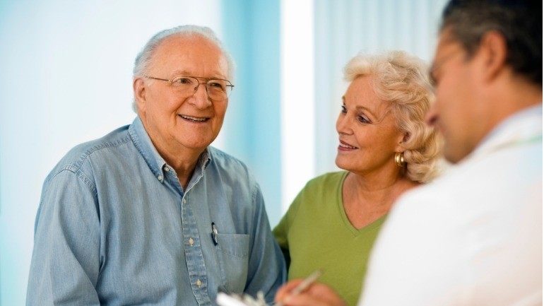 senior couple discussing paying for senior care