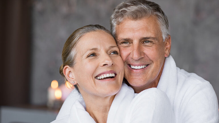 Happy couple who found out the true market value of their life insurance policies.