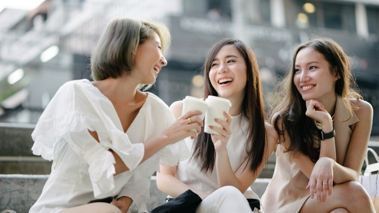 Women talking long term disability over coffee.
