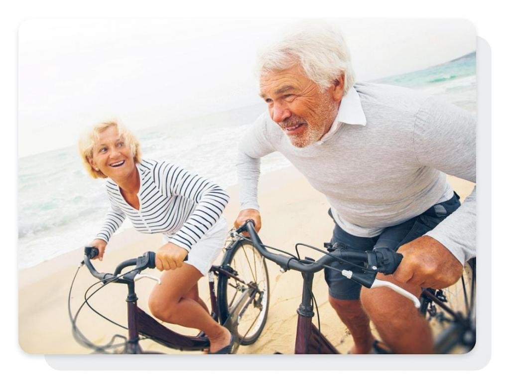 couple riding bikes after life settlements